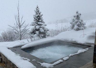 outdoor pool snow surrounding colorado