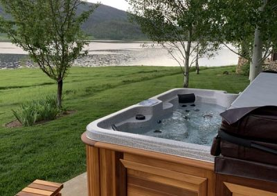 hot tub in backyard with beautiful view